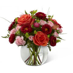 "FTD proudly presents the Better Homes and Gardens Color Rush Bouquet. A sweet symphony of bold color, this bouquet of orange roses, red matsumoto asters, pale pink mini carnations and lush greens create an impressive statement. Arranged in a clear glass bubble bowl, this bouquet will spread smiles at every turn. GOOD bouquet includes 8 stems. Approx. 11""H x 12""W. BETTER bouquet includes 12 stems. Approx. 12""H x 13""W. BEST bouquet includes 16 stems. Approx. 13""H 14""W. <br>"