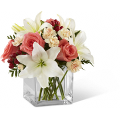 "The FTD Blushing Beauty Bouquet is a simply stunning bouquet of floral elegance and grace. Coral roses are set to capture their attention arranged amongst white Asiatic lilies, peach mini carnations, red hypericum berries and lush greens. Presented in a clear glass cubed vase, this bouquet creates a wonderful gift of blooming beauty. GOOD bouquet includes 9 stems. Approx. 9""H x 10""W. BETTER bouquet includes 13 stems. Approx. 10""H x 11""W. BEST bouquet includes 16 stems. Approx. 11""H x 13""W. <br>"