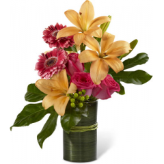 "The FTD Sweetness & Light Arrangement is a gorgeous gift set to celebrate any of life's special moments. Hot pink roses and gerbera daisies are bright and beautiful arranged amongst peach Asiatic lilies, green hypericum berries and stunning Fatsia leaves. Presented in a clear glass vase wrapped in a ti green leaf material accented with raffia ribbon, this bouquet blooms with a sweet sophistication to delight your special recipient. GOOD bouquet includes 7 stems. Approx. 17""H x 16""W. BETTER bouquet includes 10 stems. Approx. 19""H x 16""W. BEST bouquet includes 13 stems. Approx. 21""H x 16""W. <br>"