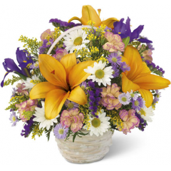 This garden basket is a display of the bright colors of nature. Arrangement includes lilies, iris, daisies and more.<br>