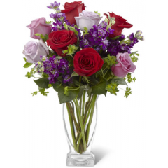 """The FTD Garden Walk Bouquet is an exquisite expression of natural beauty and grace. Assorted lavender roses, rich red roses, purple stock and lush greens have a fresh look of floral elegance presented in a modern clear glass vase to create a sweet sentiment ideal to celebrate any of life's special moments. GOOD bouquet includes 12 stems. Approx. 15""""H x 11""""W. BETTER bouquet includes 16 stems. Approx. 17""""H x 13""""W. BEST bouquet includes 21 stems.  Approx. 20""""H x 16""""W. <br>"""