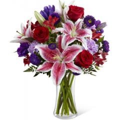 "The FTD Stunning Beauty Bouquet is an absolutely lovely way to send your love and affection across the miles. Fragrant Stargazer lilies stretch their star-like petals across a bed of rich red roses, lavender carnations, red Peruvian lilies, purple double lisianthus, purple matsumoto asters and lush greens. Presented in a classic clear glass vase, this elegant bouquet is an incredible way to convey your sweetest sentiments. GOOD bouquet includes 14 stems. Approx. 18""H x 15""w. BETTER bouquet includes 18 stems. Approx. 19""H x 16""W. BEST bouquet includes 24 stems. Approx. 20""H x 17""W. <br>"