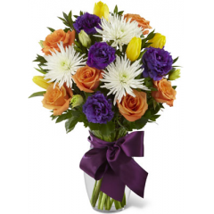 """The FTD New Dream Bouquet blooms with roses and tulips to dress up their day in color and fresh beauty. Orange roses, yellow tulips, white spider chrysanthemums, purple double lisianthus and lush myrtle are exquisitely arranged in a clear glass vase accented with a mauve satin ribbon to create the perfect way to send your congratulations and warmest wishes. GOOD bouquet includes 15 stems. Approx. 18""""H x 14""""W. BETTER bouquet includes 18 stems. Approx. 19""""H x 15""""W. BEST bouquet includes 22 stems. Approx. 20""""H x 16""""W. <br>"""