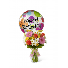 """The FTD Birthday Cheer Bouquet is set to celebrate with its bright, beautiful blooms wishing your special recipient every happiness on their big day! Coral roses, yellow spray roses, hot pink gerbera daisies, white traditional daisies, solidago and lush greens are perfectly arranged in a classic clear glass vase tied with pink satin and green chenille ribbons. Arriving with a mylar balloon exclaiming, """"Happy Birthday,"""" this bouquet will add to the warmth and happiness of their birthday festivities. GOOD bouquet includes 11 stems. Approx. 16""""H x 11""""W. BETTER bouquet includes 15 stems. Approx. 17""""H x 12""""W. BEST bouquet includes 21 stems. Approx. 19""""H x 13""""W. <br>"""