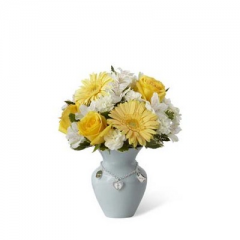 The FTD Mother's Charm Bouquet is a sweet and beautiful way to celebrate the birth of their new baby boy.  Bright yellow roses, Peruvian Lilies and gerbera daisies are highlighted by white mini carnations and a variety of lush greens, gorgeously arranged in pale blue ceramic vase displaying a silvery charm accent piece around the neck, making this a wonderful way share in the joy of this special occasion.  <br>