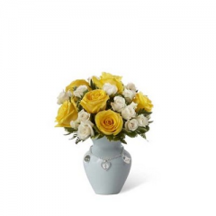 The FTD Mother's Charm Rose Bouquet is a soft, sweet display of blooming beauty set to welcome the new baby boy into the world.  Bright yellow roses and white spray roses are gorgeously arranged amongst lush greens in a soft blue ceramic vase displaying a silvery charm accent piece around the neck, to create a bouquet that expresses your warmest wishes to the new family.  <br>