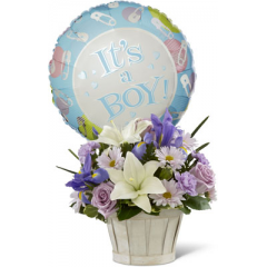 """The FTD Boys Are Best! Bouquet is blooming with sweet love to congratulate the new family on their darling baby boy! Lavender roses, blue iris, lavender carnations, lavender daisies, white Asiatic lilies and lush greens are beautifully arranged in a round whitewash woodchip basket. Presented with a Mylar balloon declaring, """"It's a Boy!"""" this incredible flower arrangement is the perfect welcome for their new addition. GOOD bouquet includes 12 stems. Approx. 11""""H x 13""""W. BETTER bouquet includes 15 stems. Approx. 12""""H x 14""""W. BEST bouquet includes 19 stems. Approx. 13""""H x 15""""W.  <br>"""