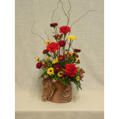 """Carnations, viking poms, hypericum berries, and matsumoto asters arranged in a stylish horse head and mane ceramic.  Sure to delight any equestrian!  Approx. 24""""H x 12""""W"""