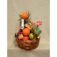 Gift basket with gourmet items and fruit. Substitutions may be necessary depending on availability of product.  We offer a variety of items and seasonal selection of local fruits.