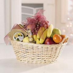Gift basket with gourmet items and fruit.  Substitutions may be necessary depending on availability of product.
