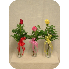 A single medium stem rose in a bud vase.  Price includes one item only.