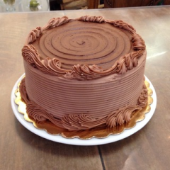 "8"" Chocolate Cake with Chocolate frosting that serves 8-10 people. Available in other flavors! **Not Available For Same Day Delivery** (Plate not included, delivered in box)"