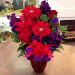A Red Hat Society themed bouquet, complete with red feathers!