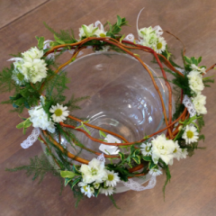 A beautiful halo made with curly willow, plumosa, larkspur, and monte casino with a little bit of lace ribbon.
