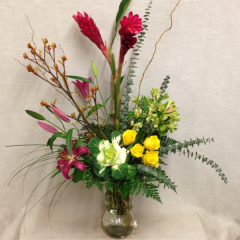 A striking unique arrangement of ginger, kangaroo paws, dark oriental lilies, kale, alstroemeria, and roses.  This arrangement stands over 3 feet tall!