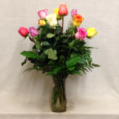 1 dz. assorted color roses arranged in a vase.  (Assortment will not include red roses, designer's choice of colors.)