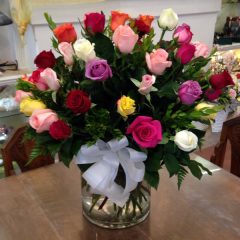 4 dozen beautiful long stem roses arranged in a large cylinder vase.  Colors will vary.
