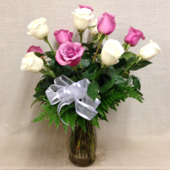 A beautiful arrangement of white and lavender long stem roses.  Add filler for a bit more.