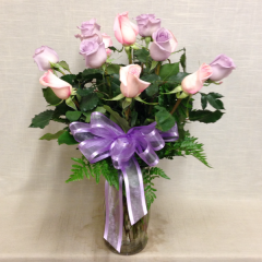 A beautiful arrangement of pink and lavender long stem roses.  Add filler for a bit more.