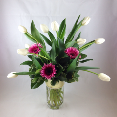 A beautiful arrangement of tulips and gerberas.  Can be made in other colors, let us know what you like in the special instructions area of your order.