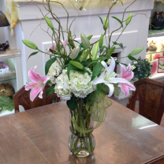 A stunning arrangement of oriental lilies in both pink and white with hydrangeas and curly willow.  This arrangement stands approx. 28in. tall (not including the curly willow accents)