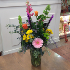 A Beautiful Designer Choice Bouquet of Assorted Colors of California Grown Flowers in a vase.