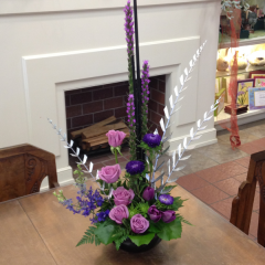 "A beautiful arrangement in purples and lavenders, with silver accents.  A beautiful tribute to our hometown team, the Sacramento Kings.  Approx. 32""H x 19""W"