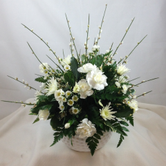 "A beautiful all white arrangement in a golf ball container.  Give us a call if you'd like some color in your arrangement!  Approx. 12""H x 10""W"