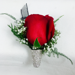 Dress up your standard boutonniere with this rhinestone holder. It comes with your choice of ribbon and roses (please specify color in special instructions). The magnetic back makes this easy to wear. This touch of sparkle pairs well with out Rhinestone Wristlets (see photo) Be the gentleman everyone remembers with this elegant touch.
