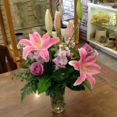 "This beautiful bouquet of roses, stock, and pink oriental lilies is sure to delight more than just a sense of smell!  Approx. 19""H x 16""W"