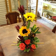 "Beautiful Fall arrangement of sunflowers, roses, safari sunset, croton plant, and bamboo.  28""H x 16""W"