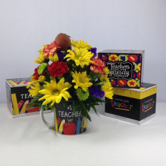 """Back to school time!  Welcome your favorite teacher into the new year with this bright and cheery arrangement in a Teacher's coffee mug.  Approx. 10""""H x 9""""W"""