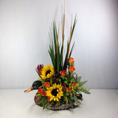 "A handsome arrangement in a Mallard Duck container.  Approx. 22""H x 12""W"