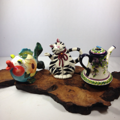 Varied ceramic teapots.  We can make an arrangement in one too!  Give us a call to get flower specifics.  Let us know which teapot you'd prefer or we'll select a nice one for you.