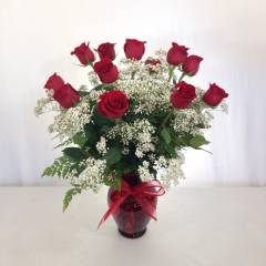 "One dozen premium long stem roses arranged with baby's breath and  in a red 11"" garden vase.  Approx. 27""H x 22""W"