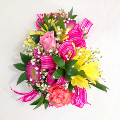 """A mixed flower wristlet corsage in bright colors.  If you'd like to specify the colors of the ribbon or flowers, let us know in the special instructions or give us a call!  This corsage is on an elastic wristlet strap.  Approx. 6""""L x 4""""W"""