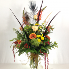 "A stunning wildflower arrangement with feathers added.  Approx. 32""H x 16""W"