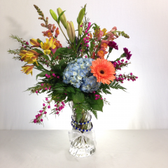 """Like it was straight out of Mom's garden.  Hydrangea, lilies, roses, alstroemeria, gerberas, carnations and snapdragons with filler.  Approx. 25""""H x 12""""W"""