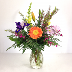"Express your gratitude with this beautiful arrangement of gerberas, lilies, iris, poms, snapdragons, and boronia.  Approx. 20""H x 13""W"