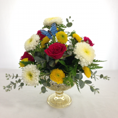 "A cute arrangement in a compote footed vase.  Approx. 10""H x 10""W"