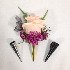 A rose boutonniere with your choice of filler and your choice of ribbon color.  Let us know what color of rose and ribbon color in the special instructions or give us a call at the shop.  Boutonniere holder comes in gold, silver, or black.