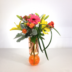 """A festive arrangement of oranges, yellows, and hot pinks in a cylinder bulb bottom vase.  Approx. 18""""H x 12""""W"""