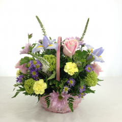 "A pretty pastel arrangement of flowers in a pastel basket, colors will vary.  Approx. 12""H x 12""W"