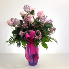 "A beautiful arrangement of pink and lavender roses.   Approx. 24""H x 16""W"