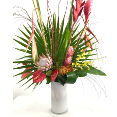 This stunning display of tropicals is breathtaking. Featuring king protea, anthurium, heliconia, ginger, lilies, oncidium orchids and more.  There are lights that are interwoven to illuminate this beauty.