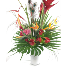 Tropical greens frame this exotic arrangement featuring anthurium, birds of paradise, heliconia,  lilies and ginger accented with Ostrich feathers and lights to make this stunner glow.