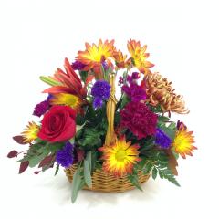"An Autumn colored basket arrangement.  Approx. 12""H x 13""W"