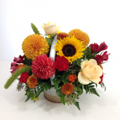 "A collection of fall colored flowers in a two tone metal gold and tin container.  Approx. 12""H x 13""W"