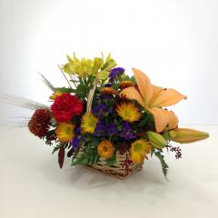 "A natural, fall themed basket arrangement.  Approx. 11""H x 16""W"