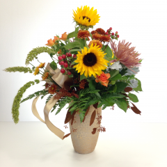 "A golden hued arrangement in a gold decorative vase.  Approx. 19""H x 13""W"